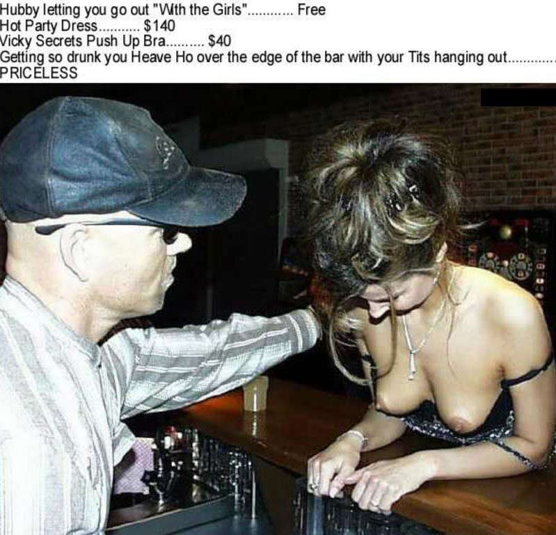 Woman drunk in a bar with her titts hanging out
