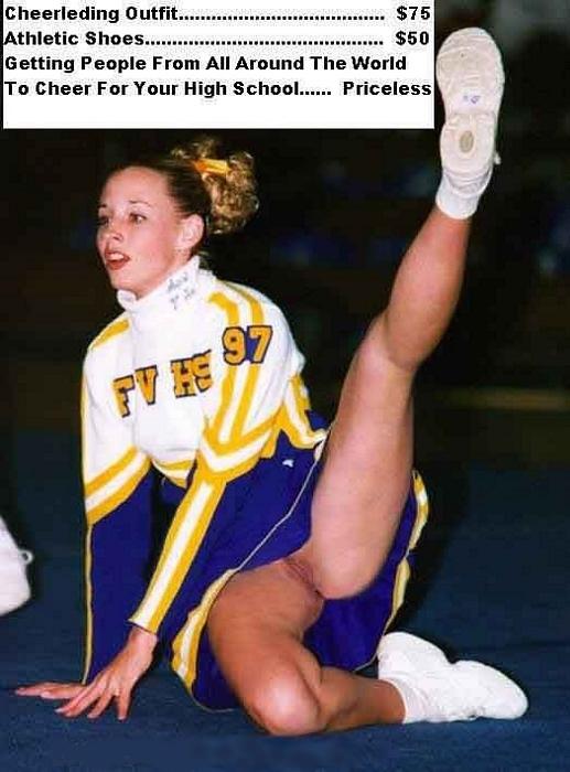 Cheerleader girl raising her leg with no panty below her dress